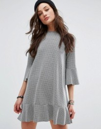 http://www.asos.com/pullbear/pullbear-gingham-frill-sleeve-dress/prd/7732915?iid=7732915&clr=Black&SearchQuery=gingham%20pull%20and%20bear&SearchRedirect=true